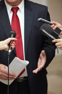 Suit-red-tie-3-mics-and-phone1